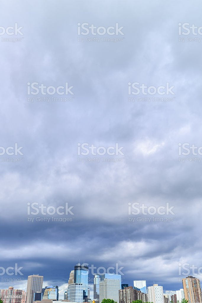 Downtown Minneapolis Skyline and Dramatic Cloudy Skys Vertical stock photo