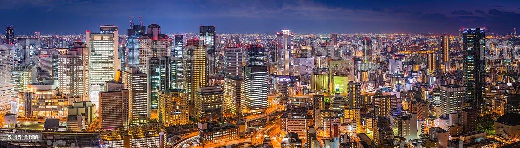 Downtown neon night futuristic cityscape skyscrapers panorama illuminated Osaka Japan stock photo