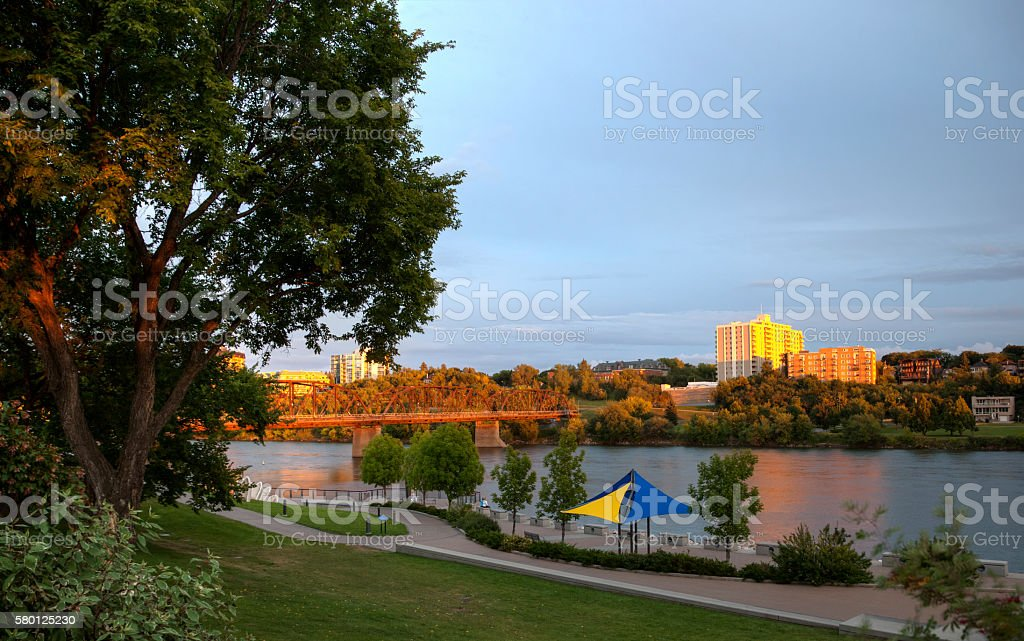 Downtown Saskatoon at Sunset Along River Landing stock photo