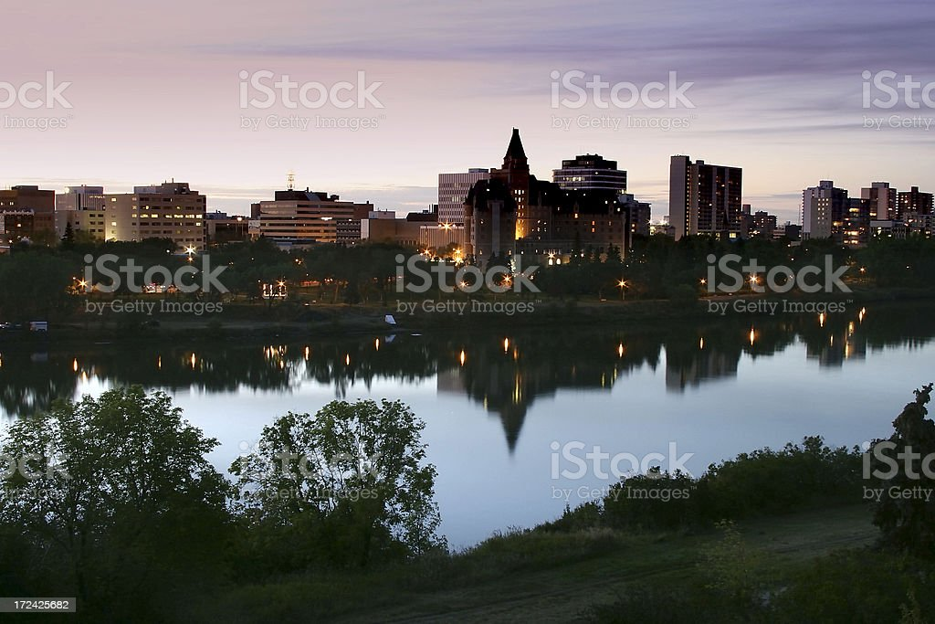 Downtown Saskatoon Sunset with Hotels and Office Buildings Along River stock photo