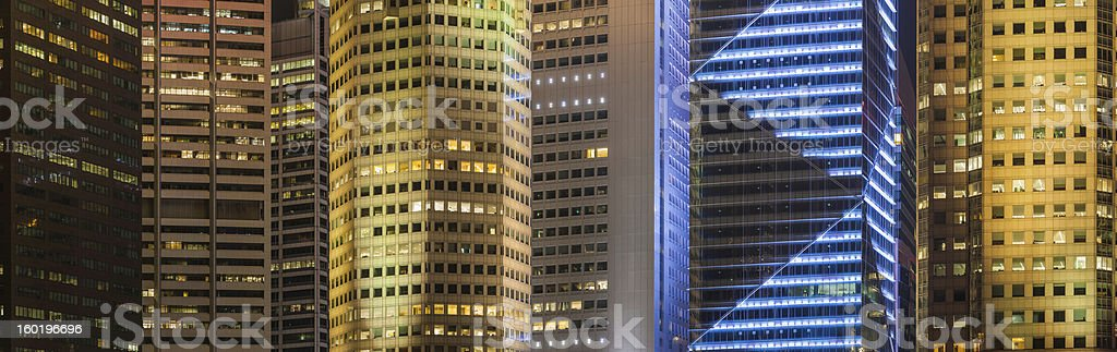 Downtown skyscraper background illuminated cityscape stock photo