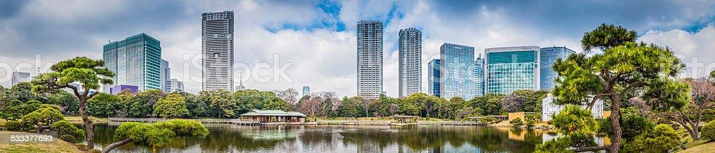 Downtown skyscrapers towering over peaceful park panorama Tokyo Japan stock photo