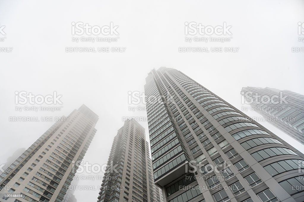 Downtown skyscrapers under the fog upward view stock photo