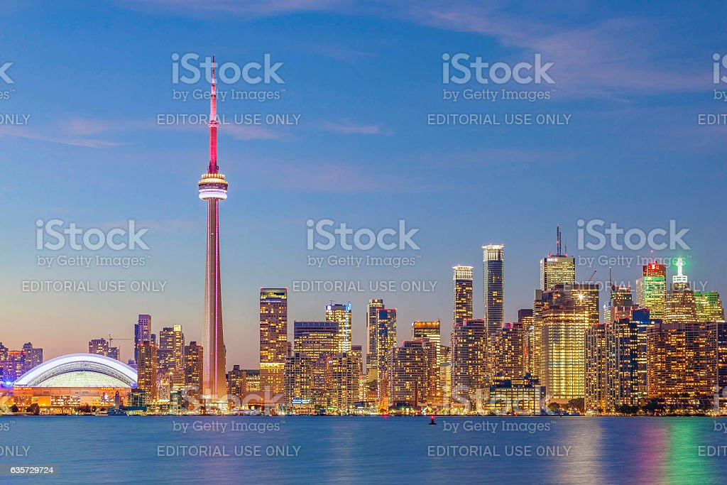 Downtown Toronto skyline illuminated after sunset stock photo