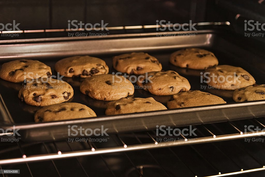 A dozen cookies baking in the oven stock photo