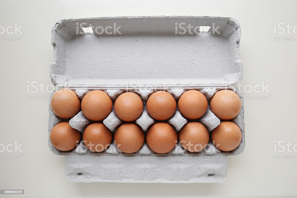 Dozen eggs in packaging stock photo