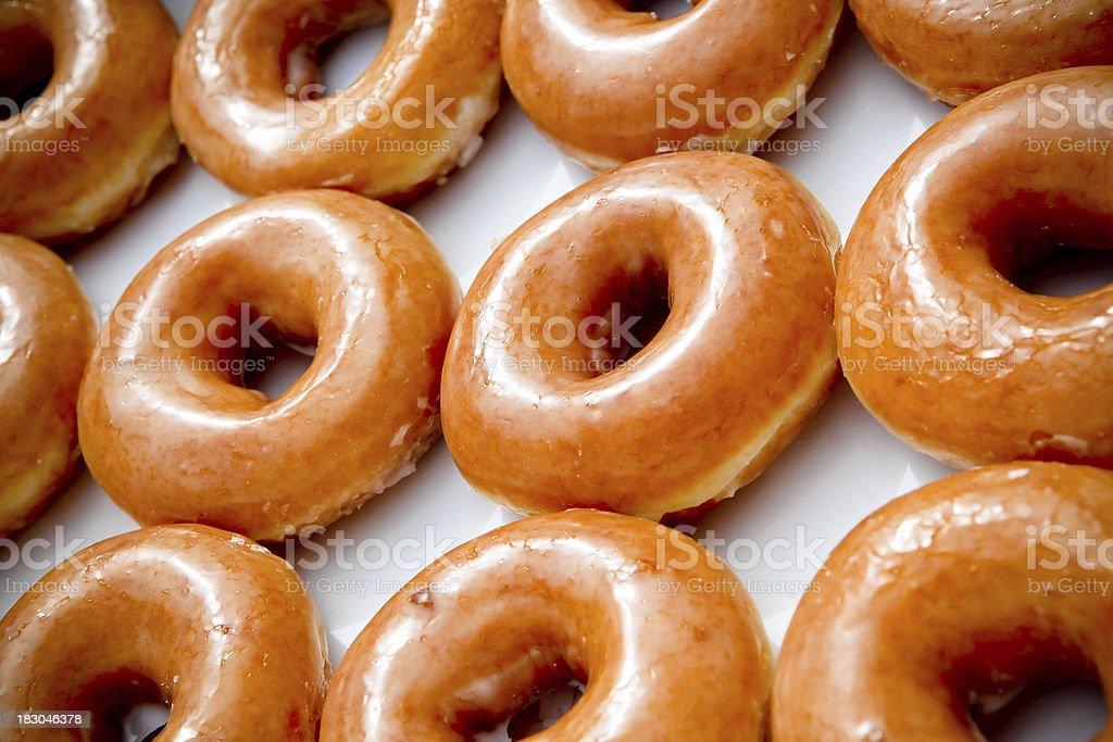 Dozen Glazed Donuts royalty-free stock photo