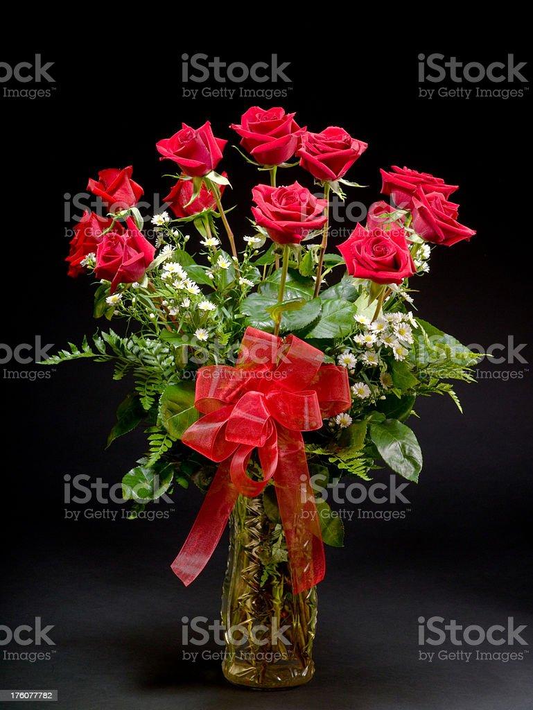 Dozen roses with black background stock photo