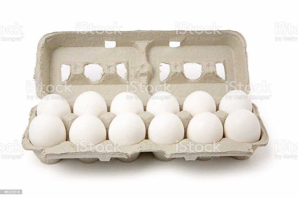 Dozen white eggs in a cardboard carton on a white background stock photo