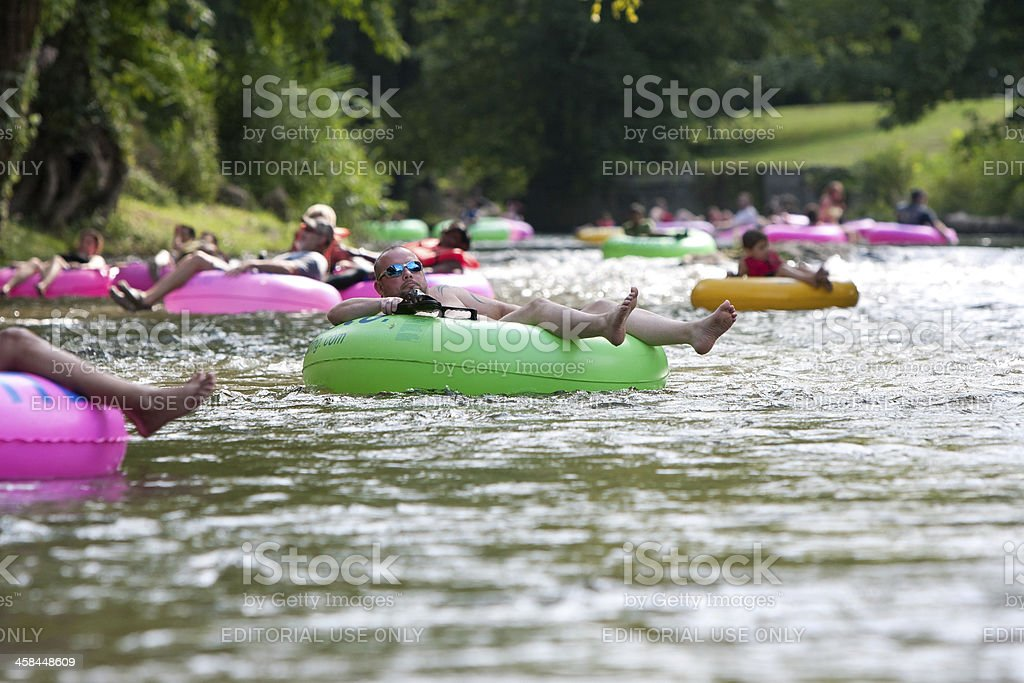 Dozens Of People Enjoy Tubing Down North Georgia River stock photo