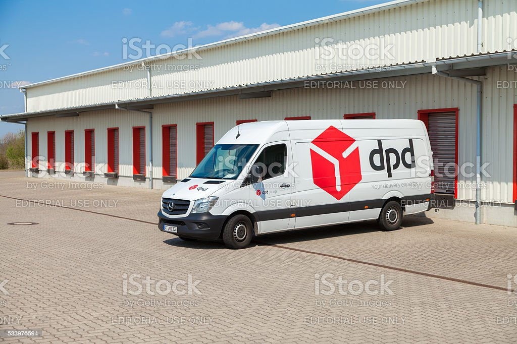 dpd van stands on logistic depot stock photo
