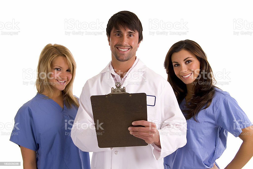 Dr and nurses reviewing a chart. royalty-free stock photo