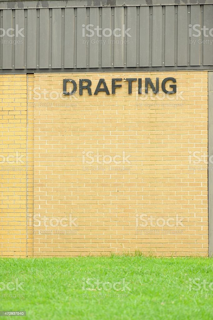 Drafting sign on building stock photo