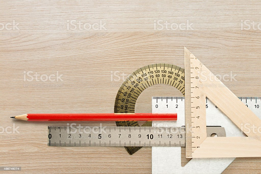 Drafting wooden and steel tools with pencil stock photo