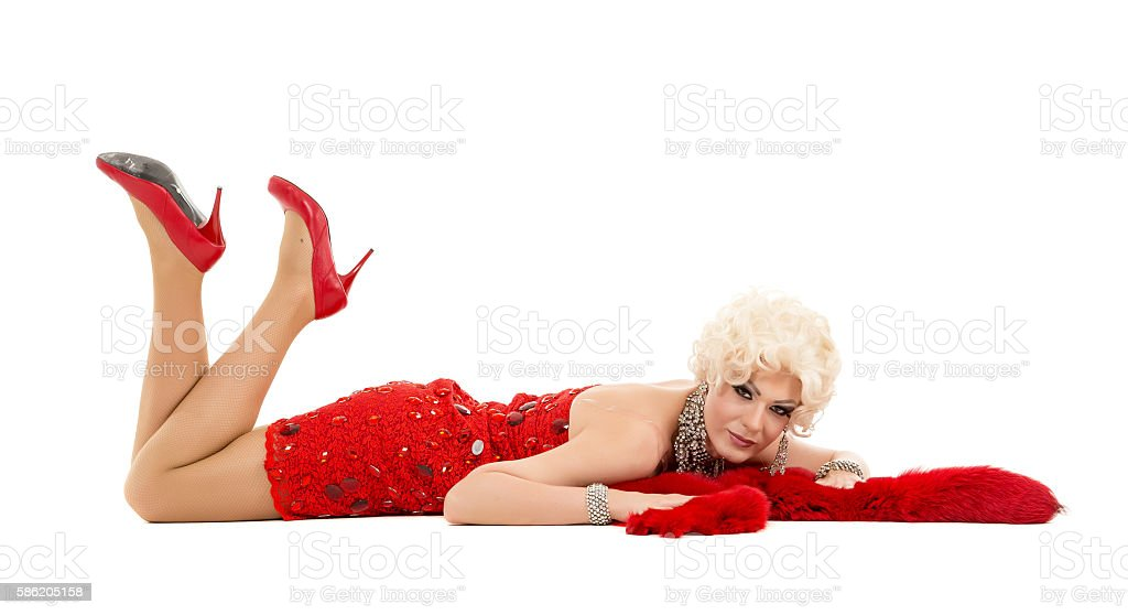 Drag Queen in Red Dress with Fur Lying stock photo
