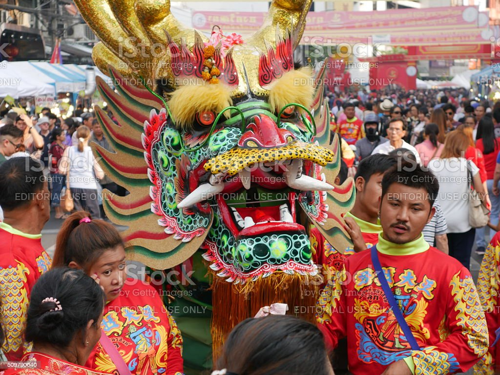 Dragon Dancers and people in China Town stock photo