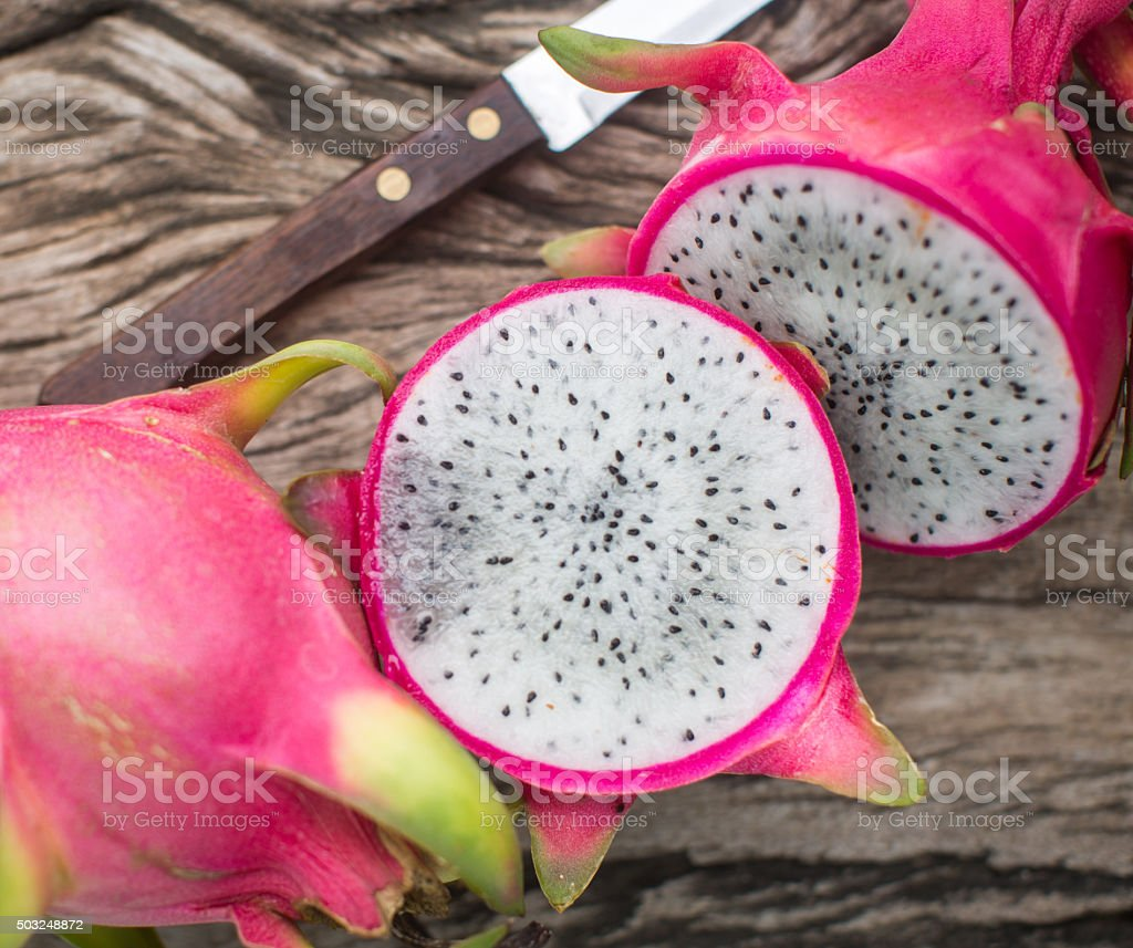 Dragon fruit on a wooden board stock photo