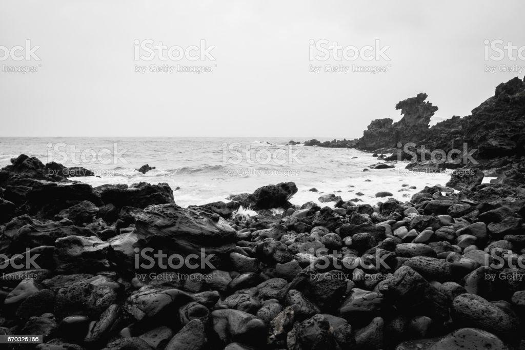 Dragon Head Rock dark or Yongduam of Jeju Island South Korea stock photo