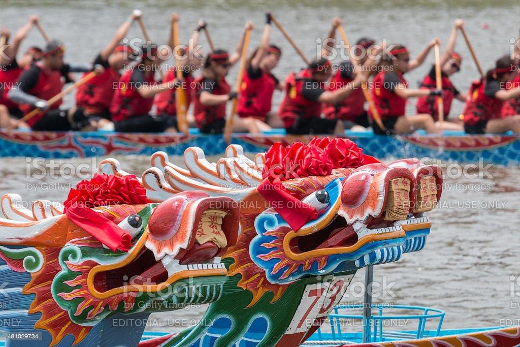 Dragon heads and dragon boat racing stock photo