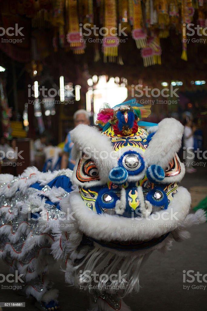 Dragon performers, Saan Jao Joe Sue Gong temple, Bangkok, Thailand. stock photo