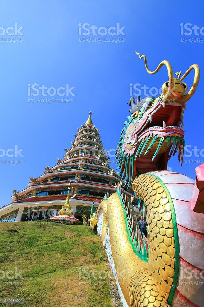 dragon sculpture and the pagoda at Wat Huay Pla Kang stock photo