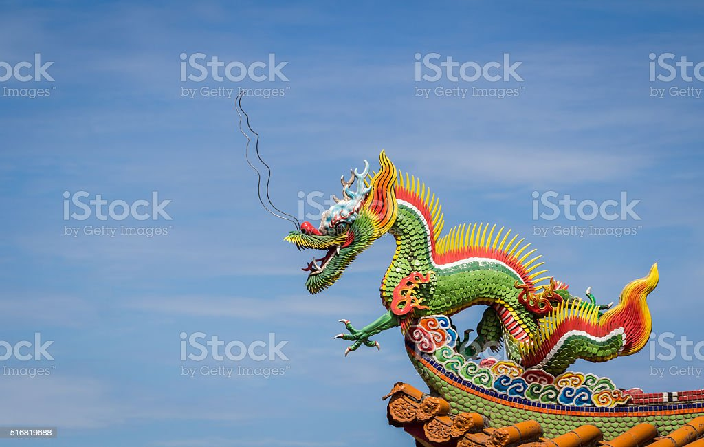 Dragon sculpture on roof. stock photo