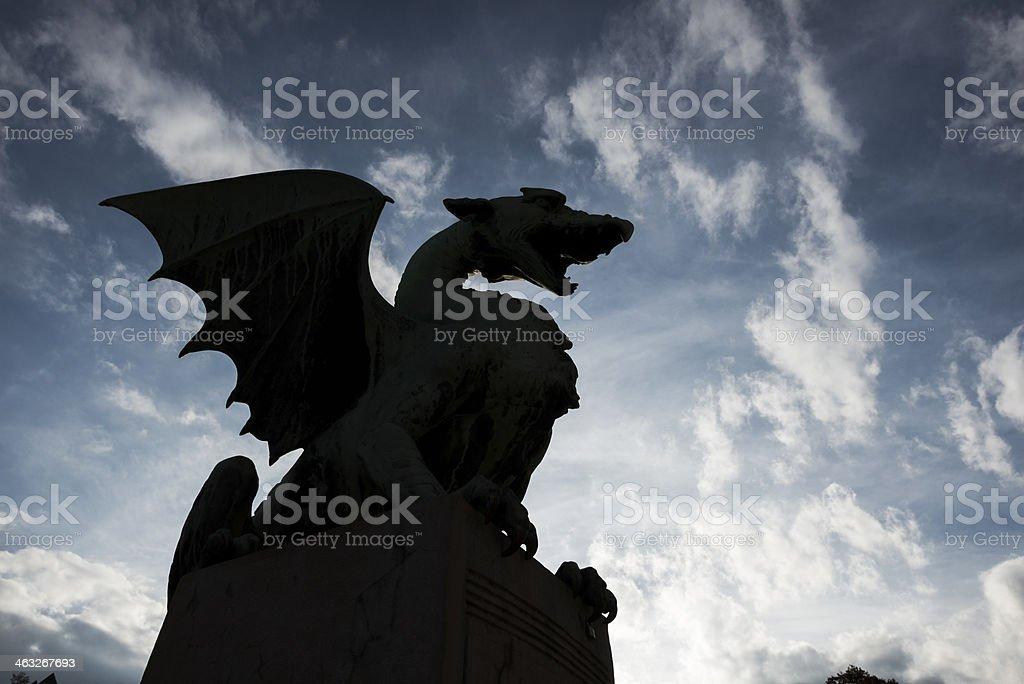Dragon silhouetted against sky in Ljubljana, Slovenia stock photo