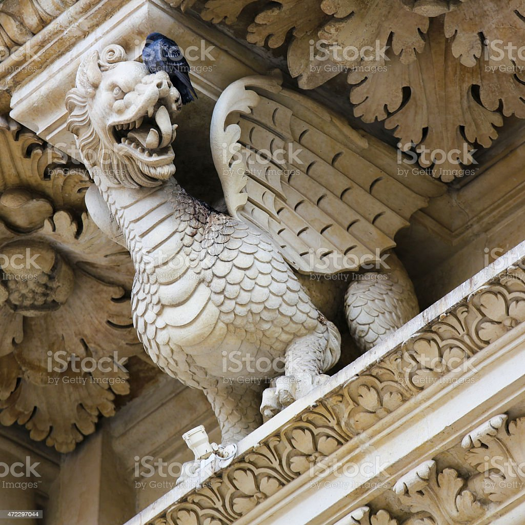 Dragon statue at the Santa Croce baroque church in Lecce stock photo