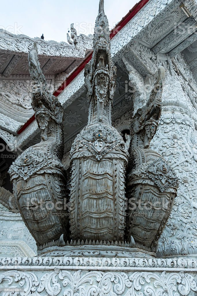 Dragon statues on Buddhist temple in Thailand stock photo