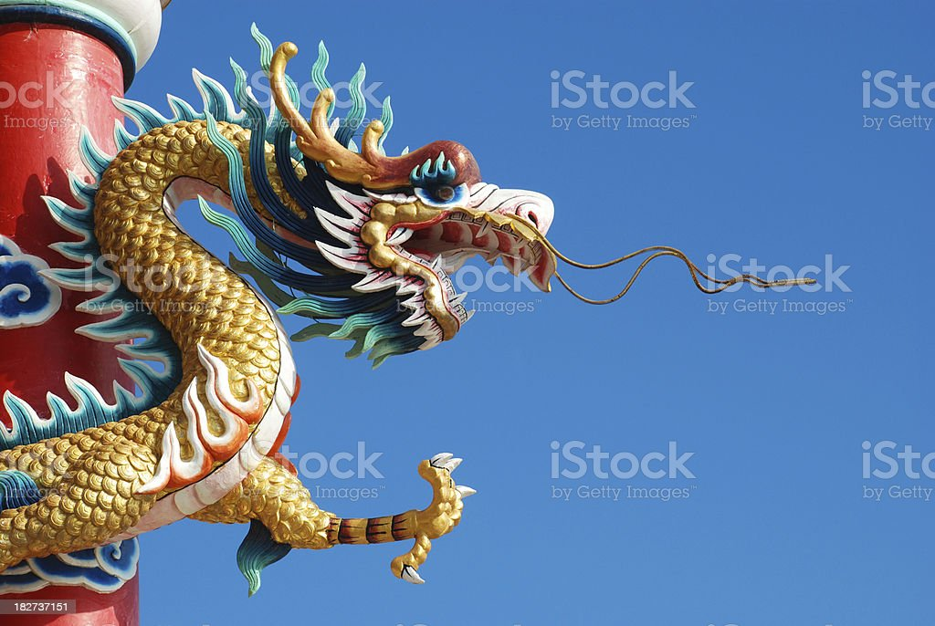 Dragon with a blue sky picture. stock photo