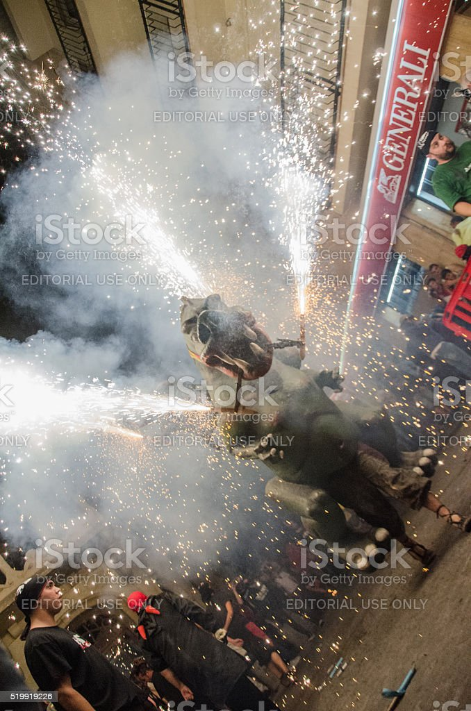 Dragon with fireworks in Canet de Mar stock photo