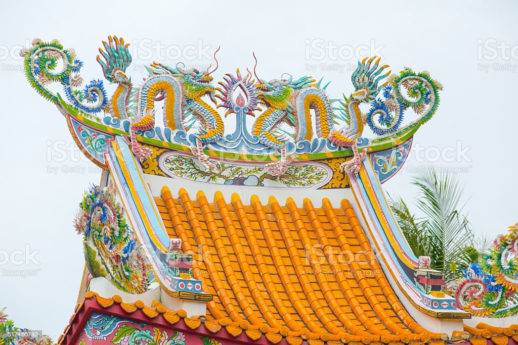 Dragons statue on the roof of Chinese temple. stock photo