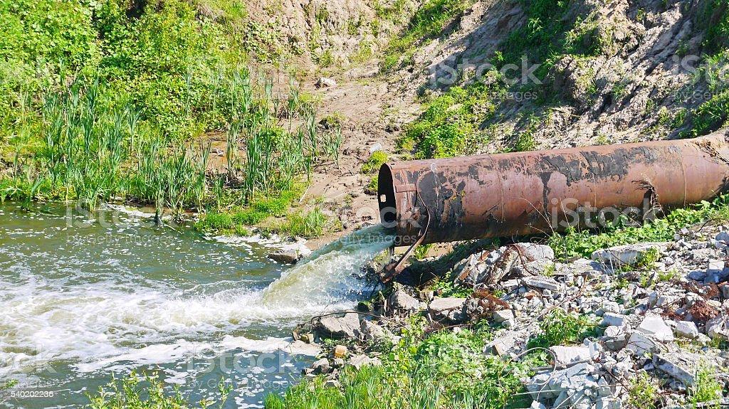 Drain pipe from dam stock photo