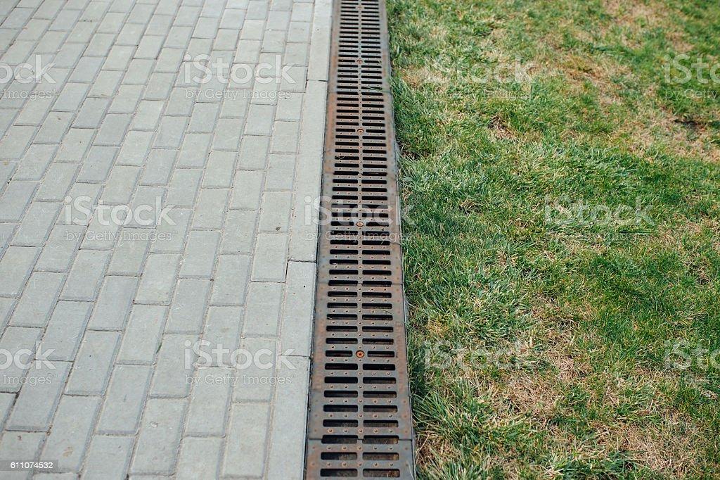 Drain water in garden stock photo