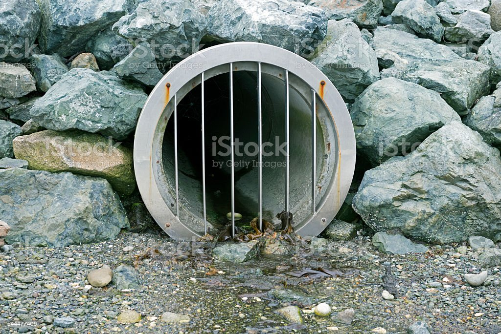 Drainage pipe into Puget Sound in Washington state stock photo