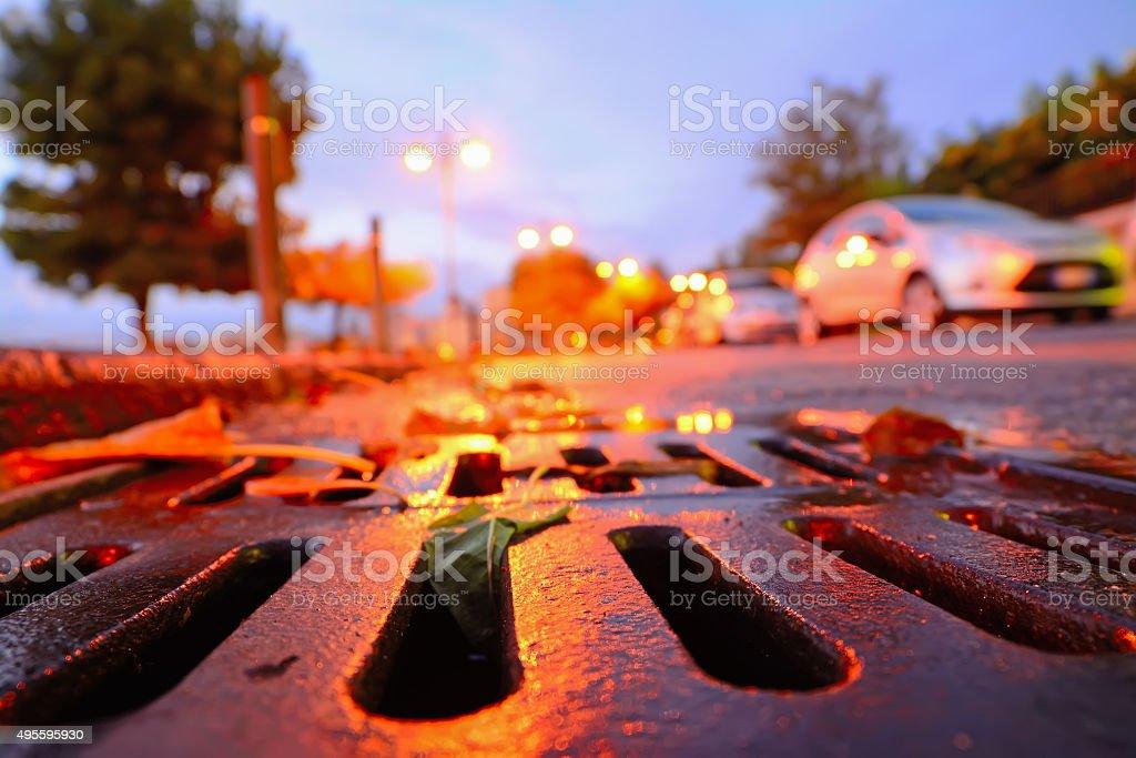 drainage sewer at sunset stock photo