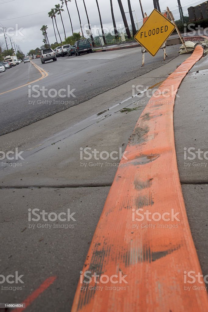 Draining hose and Flooded sign royalty-free stock photo