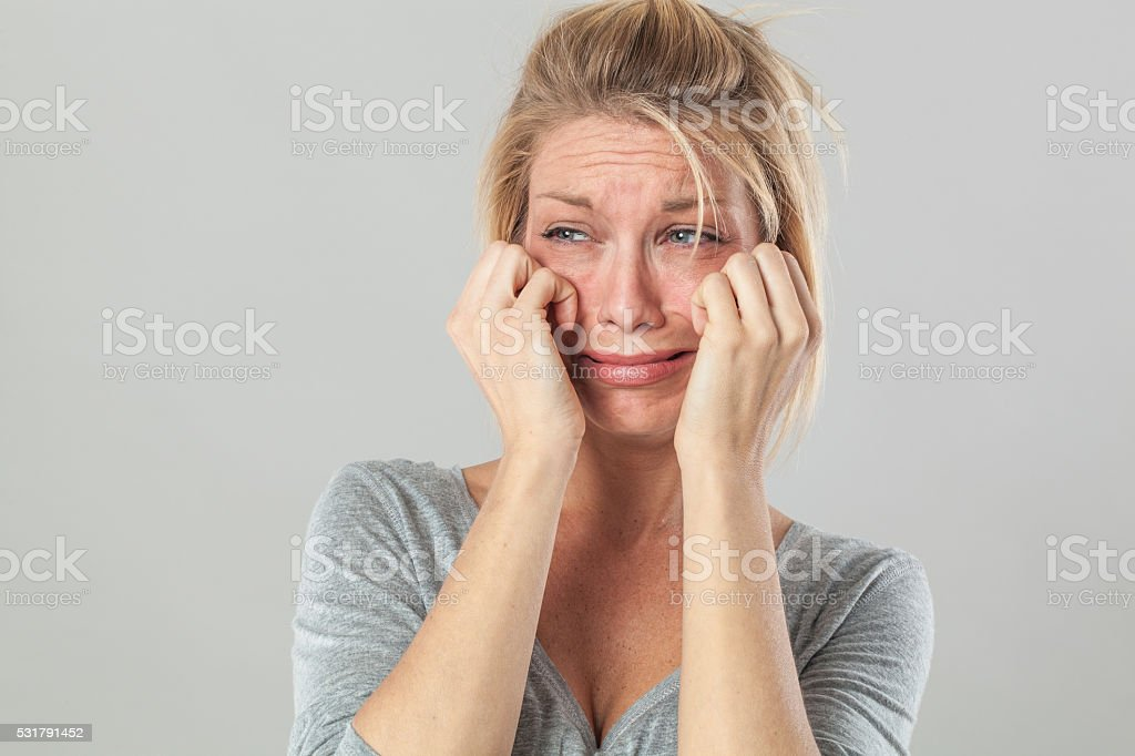 drama for blond woman crying with big tears expressing disappointment stock photo