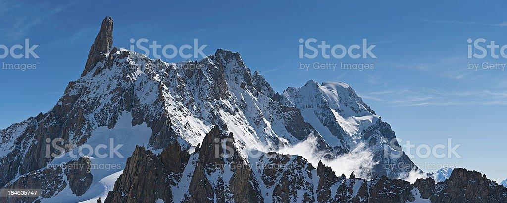 Dramatic Alpine peaks pinnacles snow cloud summits panorama stock photo