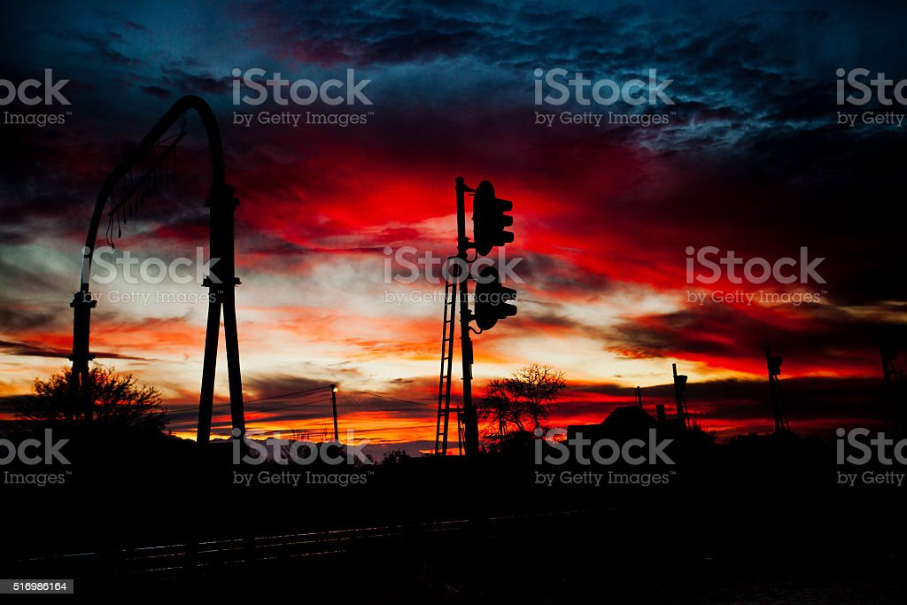 Dramatic and powerful sunset over rail tracks stock photo