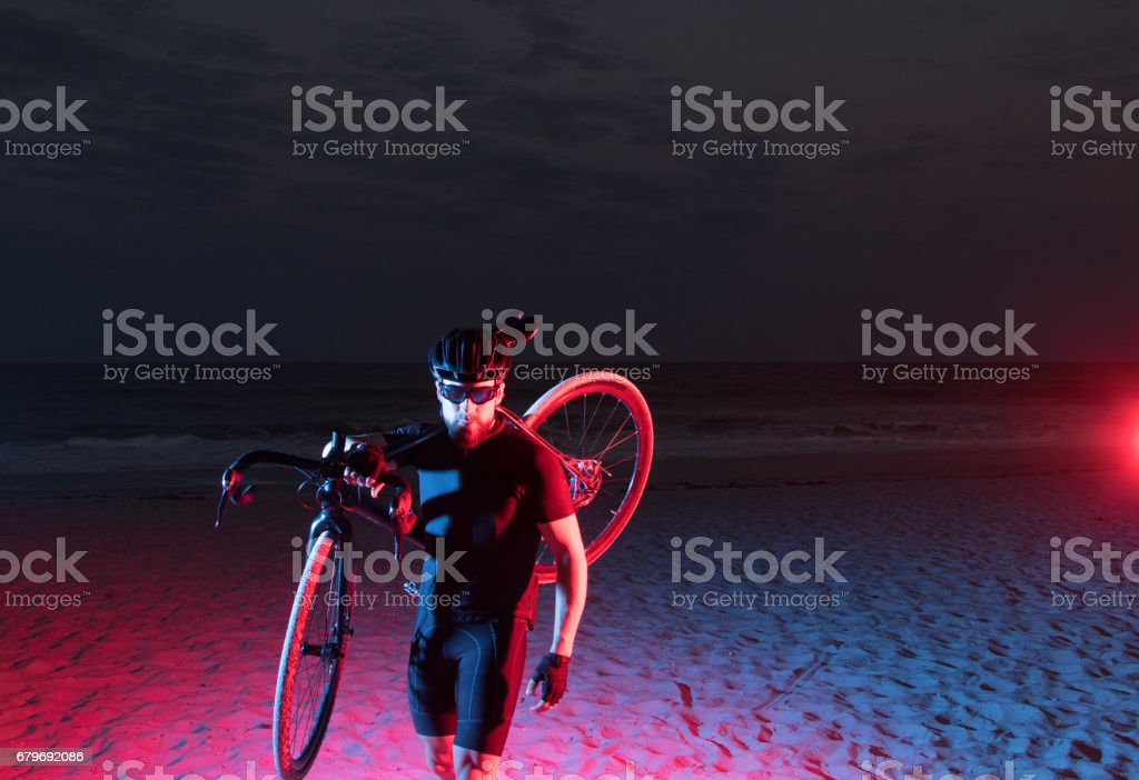 Dramatic athlete running with bicycle stock photo