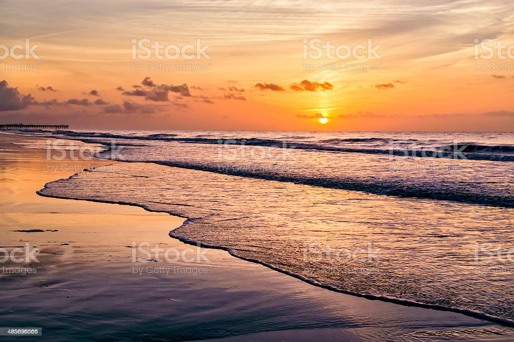 Dramatic beach sunrise or sunset stock photo