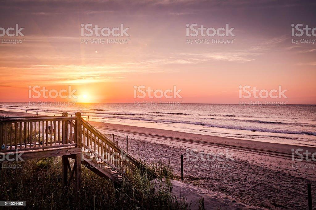 Dramatic beach sunrise or sunset stock photo