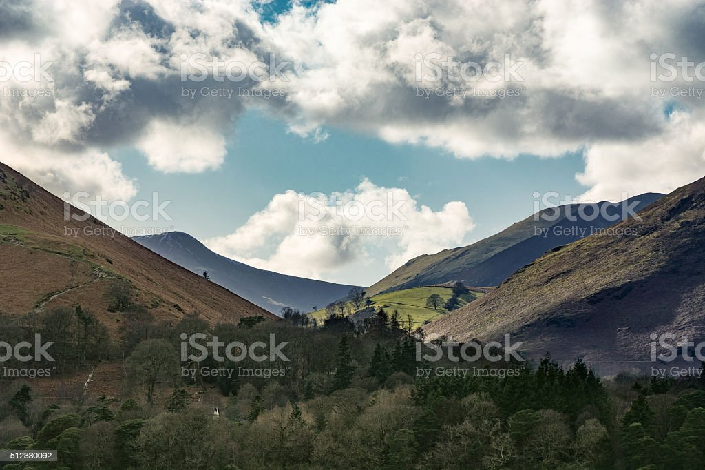 Dramatic Beautiful Clouds Over Borrowdale Mountains In Lake District. stock photo