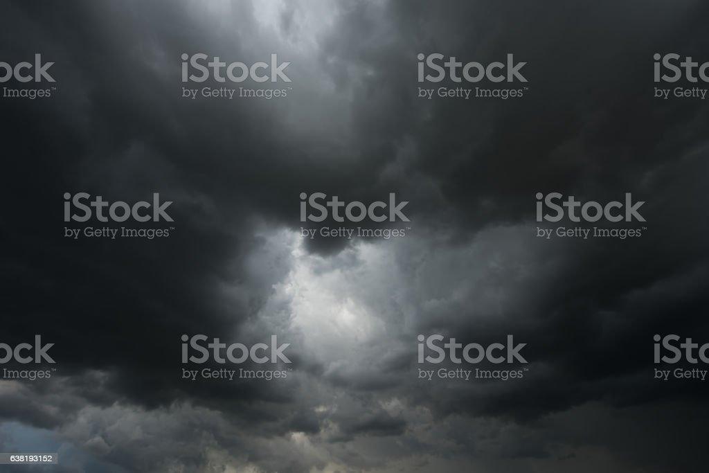 Dramatic black clouds and dark sky before rainy stock photo