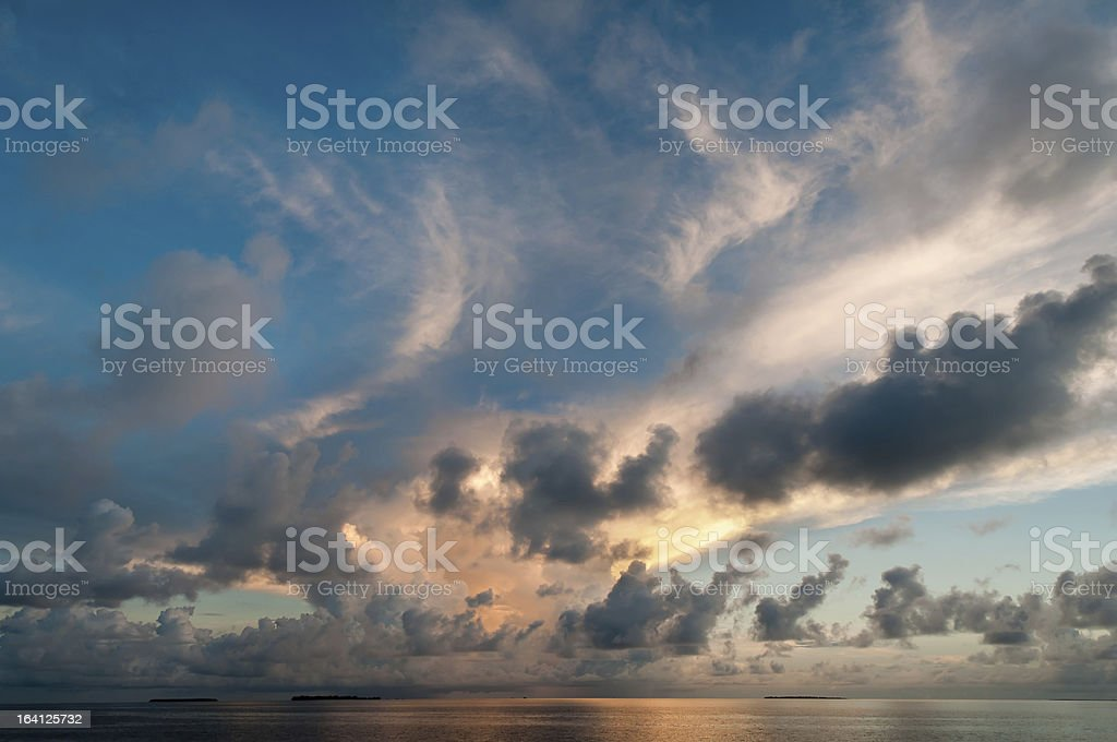 Dramatic clouds at dusk over the sea royalty-free stock photo