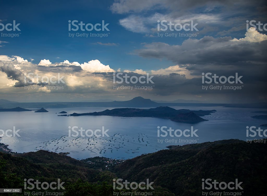 Dramatic Clouds Over Lake Taal and Volcano Island stock photo