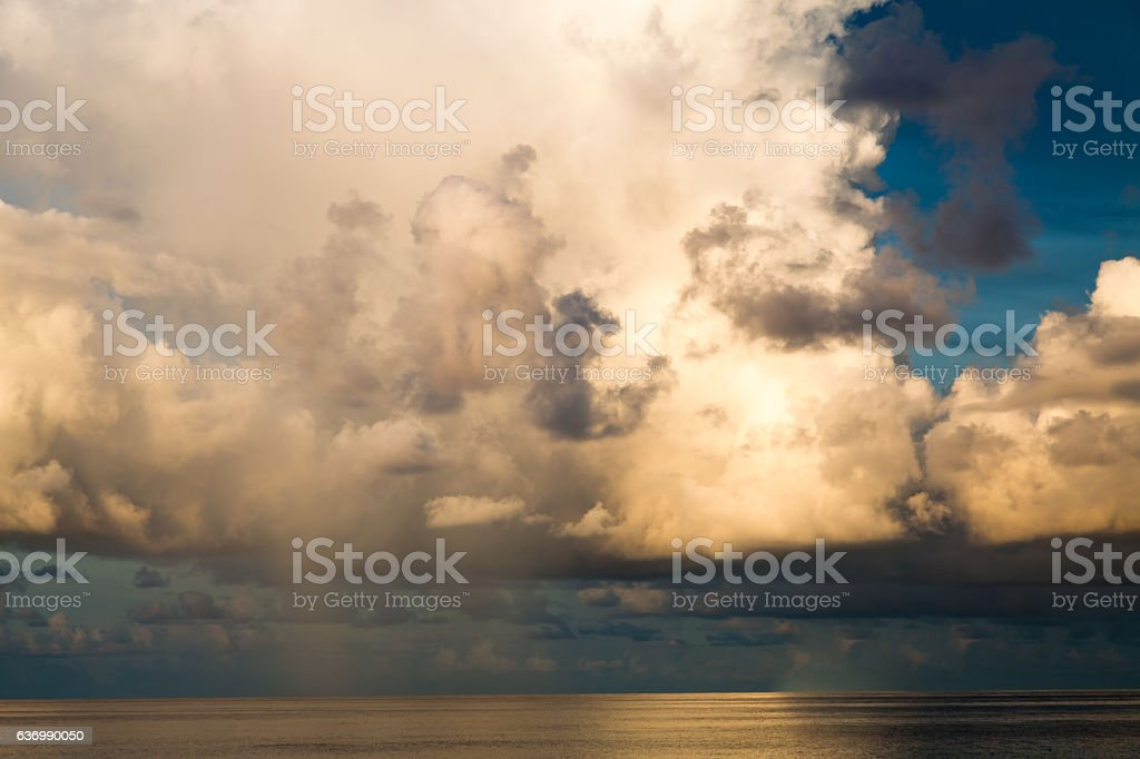 Dramatic clouds over the Caribbean sea at daybreak stock photo
