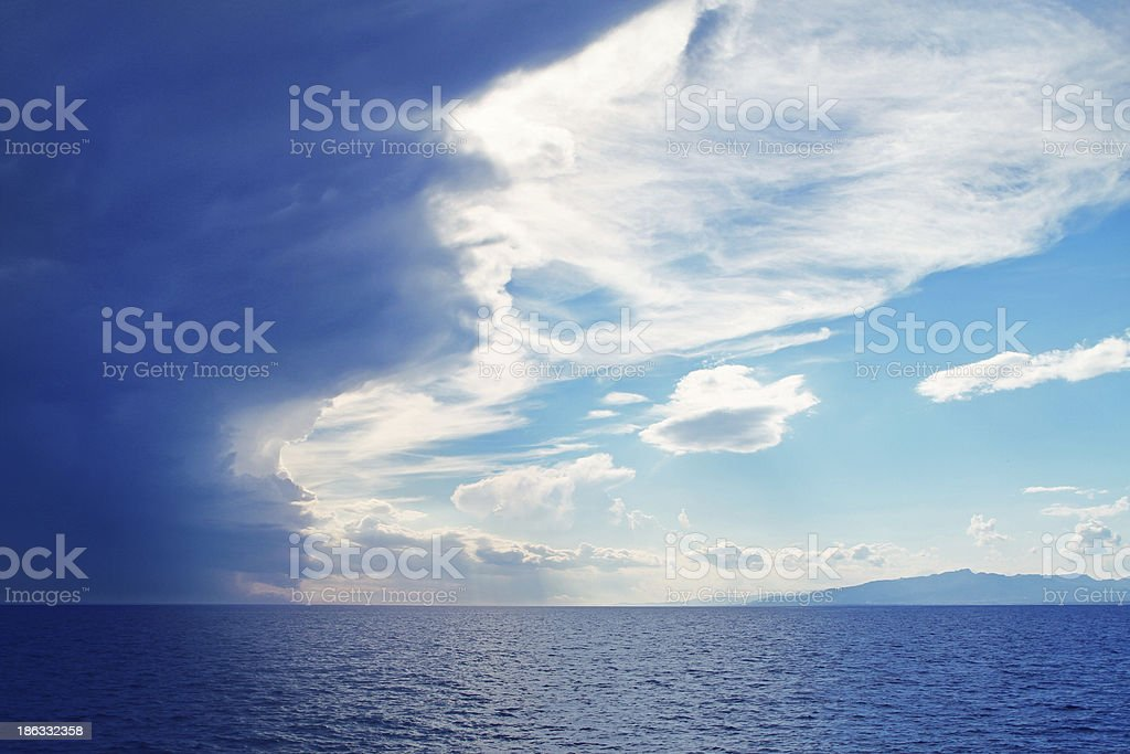 Dramatic clouds over the sea stock photo