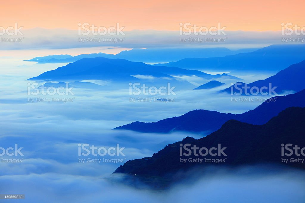 Dramatic clouds with mountain silhouette royalty-free stock photo